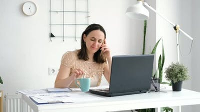 Businesswoman Talking on Phone in the Office