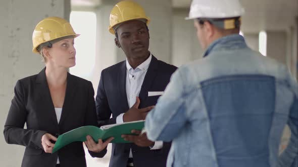 Thumbnail for Businessman Working with Architect Engineer in Building Construction Site with Blueprint Checking