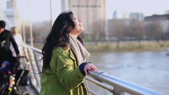 Thumbnail for Woman on bridge
