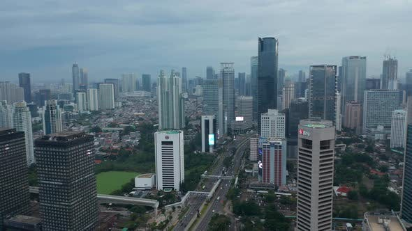 Thumbnail for Aerial Wide View of Urban Canyon with Skyscrapers and Multi Lane Traffic in Downtown Jakarta