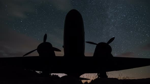 Thumbnail for Stars Turning Over Plane Silhouette