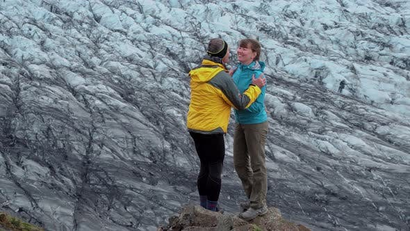 Cover Image for Tourists on the Background of the Glacier in Iceland