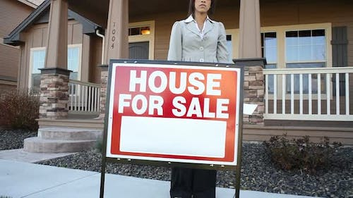 Realtor in front of a house