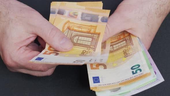 Thumbnail for Counting Euro Banknotes