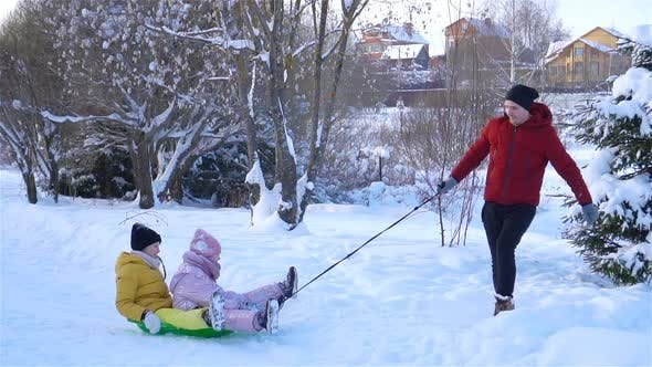 Thumbnail for Family of Dad and Kids Vacation on Christmas Eve Outdoors