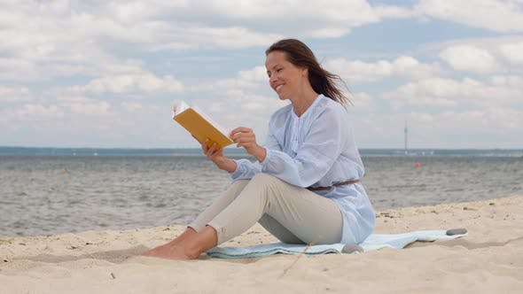 Thumbnail for Happy Smiling Woman Reading Book on Summer Beach