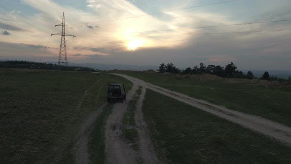 Thumbnail for Aerial view of a truck driving on a countryside road