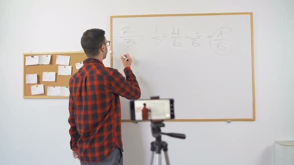 Thumbnail for Math Professor at Home, Looking and Talking Direct To Camera During Online Classroom Session