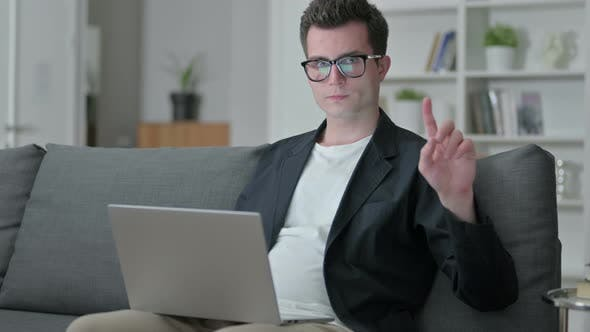 Thumbnail for Young Male Designer Giving No Sign with Finger, Disapproval