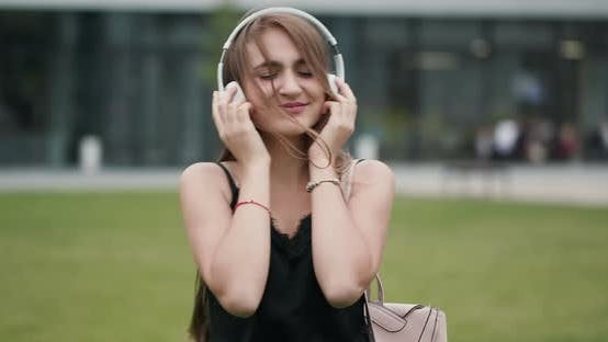 Thumbnail for Girl Listening to Music with Headphones