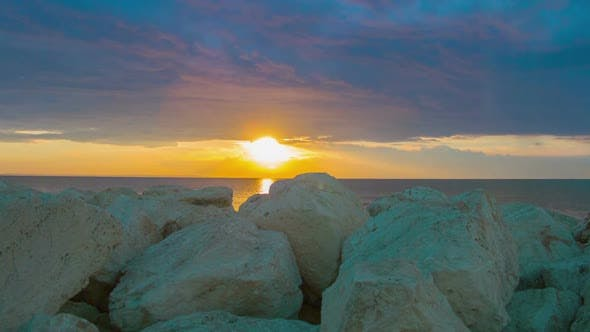 Thumbnail for Timelapse of Fantastic Sunrise Over Sea. White Stones on Coast