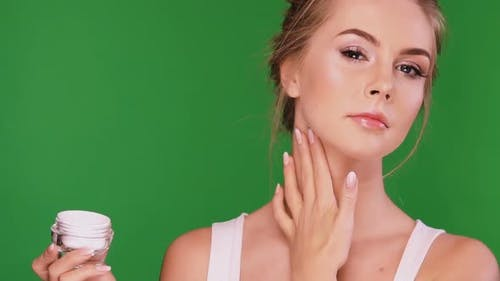 Girl with Perfect Skin Smoothing Cream on Her Neck