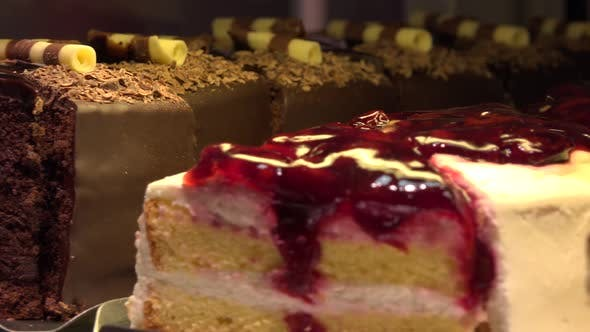 Thumbnail for Closeup on Various Slices of Cakes on Display in a Store