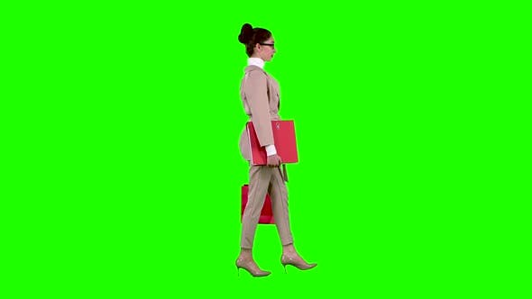 Thumbnail for Girl Goes Shopping in the Store. Green Screen. Slow Motion