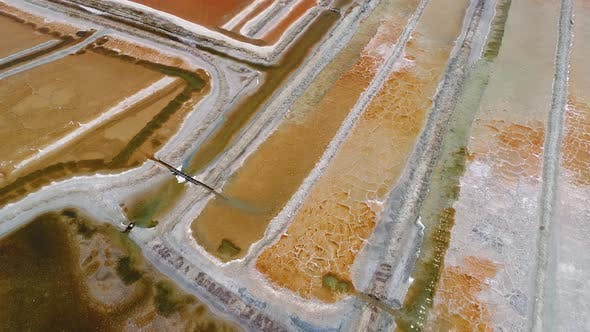 Thumbnail for Aerial view above of big salt industry near a coastal village, Brazil.