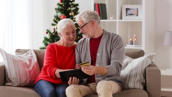Thumbnail for Old Couple with Tablet and Bank Card on Christmas 58