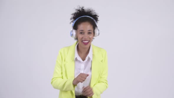 Thumbnail for Happy Young Beautiful African Businesswoman Dancing and Listening To Music