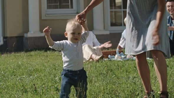 Thumbnail for Happy Toddler Boy Learning to Walk