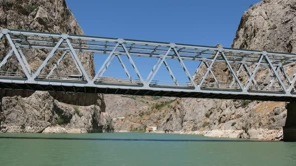 Thumbnail for Iron Car Bridge Between Mountains Above River