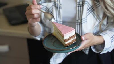 Delicious Cake on a Saucer Spoon Breaks Off a Piece