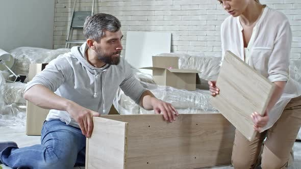 Thumbnail for Married Couple Building Shelf