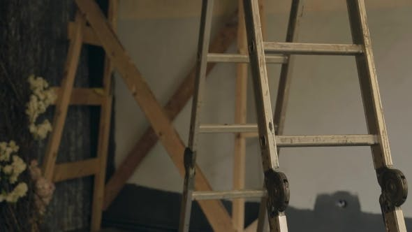 Thumbnail for Metal Stepladder Stands In Empty Room Which Is Prepared For Reconstruction.