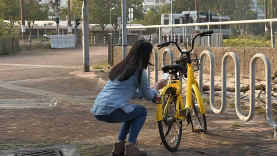 Cover Image for Woman Using Share Bike in The City