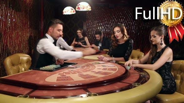 Dealer Shuffles the Young Women in the Casino