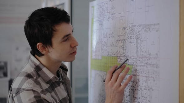 Thumbnail for A Young Student Engineer Working On Communications Plan Of City With Pencil In Hand.