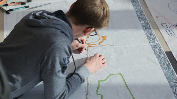 Thumbnail for Young Architect Lies On Floor And Creates Draft Of Building