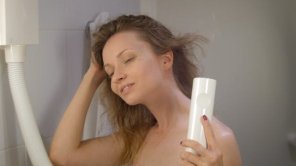 Thumbnail for Young Beautiful Girl in Bathroom of Hotel Drying Hair by Fen