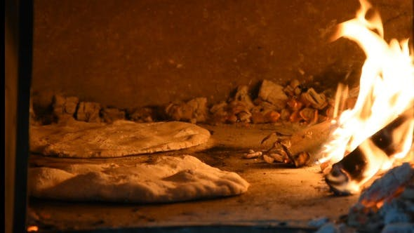 Thumbnail for Woman Making Pizza in the Wood Oven