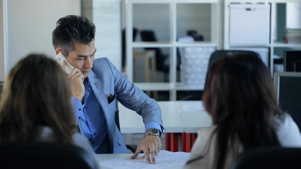 Thumbnail for Young Business Man Is Talking On Cellphone In Front Of Employee.