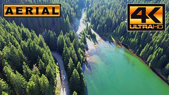 Thumbnail for Fly Over Mountain Road Through Forest Along Lake