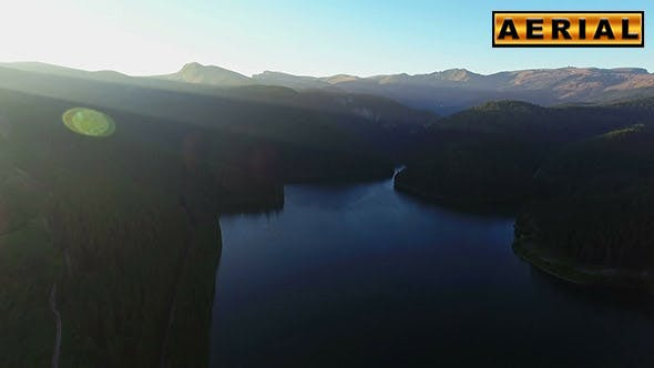 Thumbnail for Fly Over Mountain Lake At Sunset