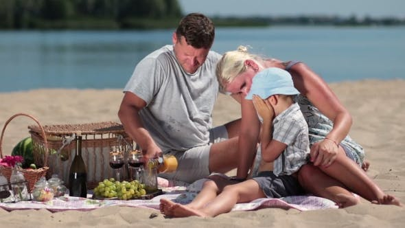 Thumbnail for Beautiful Family Picnicking On The Beach