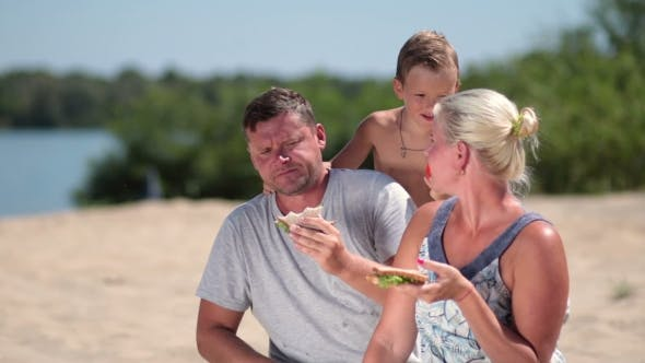 Thumbnail for Happy Family Enjoying Lunch On The Beach