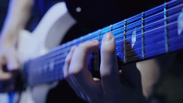 Guitarist`s Hands Playing on Guitar