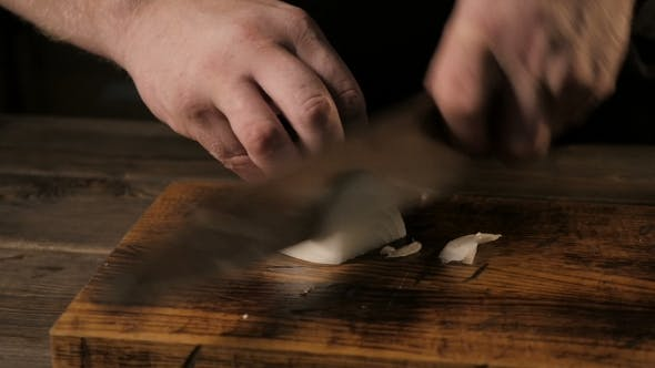 Thumbnail for Close - Up Of The Chief's Hands Cutting Onion On a Wooden Board