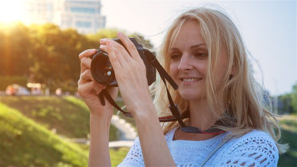 Thumbnail for Beautiful Young Female Photographer Taking Pictures 3