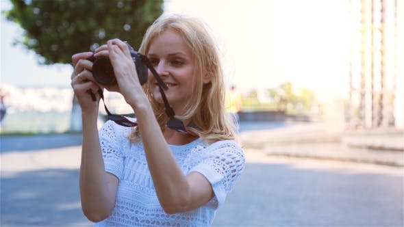 Thumbnail for Beautiful Young Female Photographer Taking Pictures 4