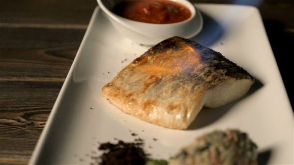 Thumbnail for Healthy Food Concept: Chef Fries Fish Served on a Plate With a Gas Burner