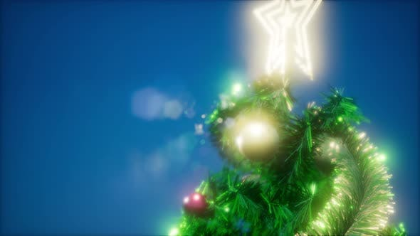 Thumbnail for Joyful Studio Shot of a Christmas Tree with Colorful Lights