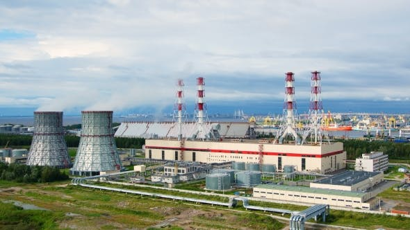 Thumbnail for timelapse of power plant with large pipes on background of the sea