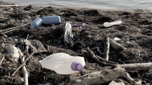 Dump Garbage On The Beach Near The Sea