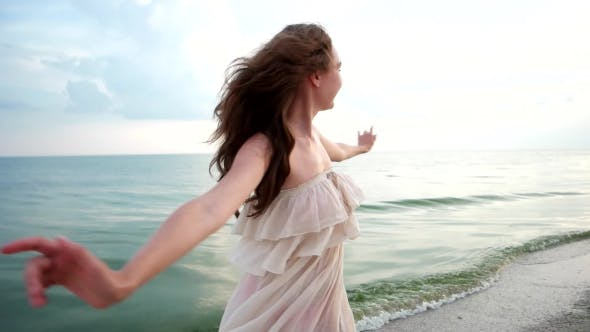 Thumbnail for Happy Girl Spinning On The Ocean