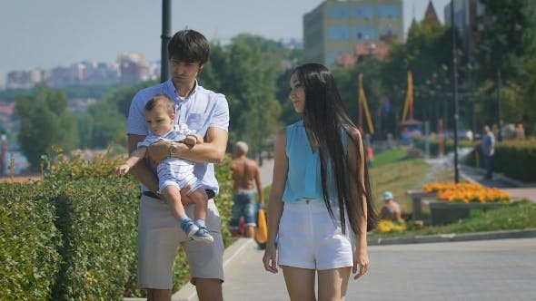 Thumbnail for Young Happy Family At Outdoors