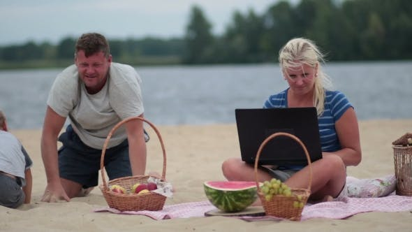 Thumbnail for Woman With Laptop Working On The Beach