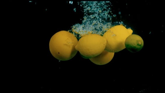 Thumbnail for Citrus Fruit In Water On a Black Background