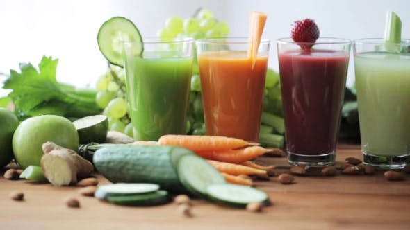 Cover Image for Glasses Of Juice, Vegetables And Fruits On Table